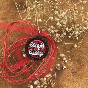 2294c94749a Jewelry - Georgia Bulldogs Bottle Cap Red Ribbon Necklace